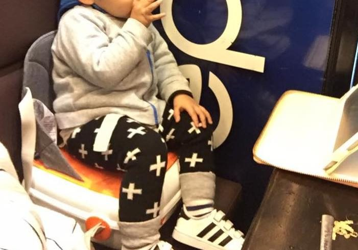 Baby Z in his booster seat at New Village.